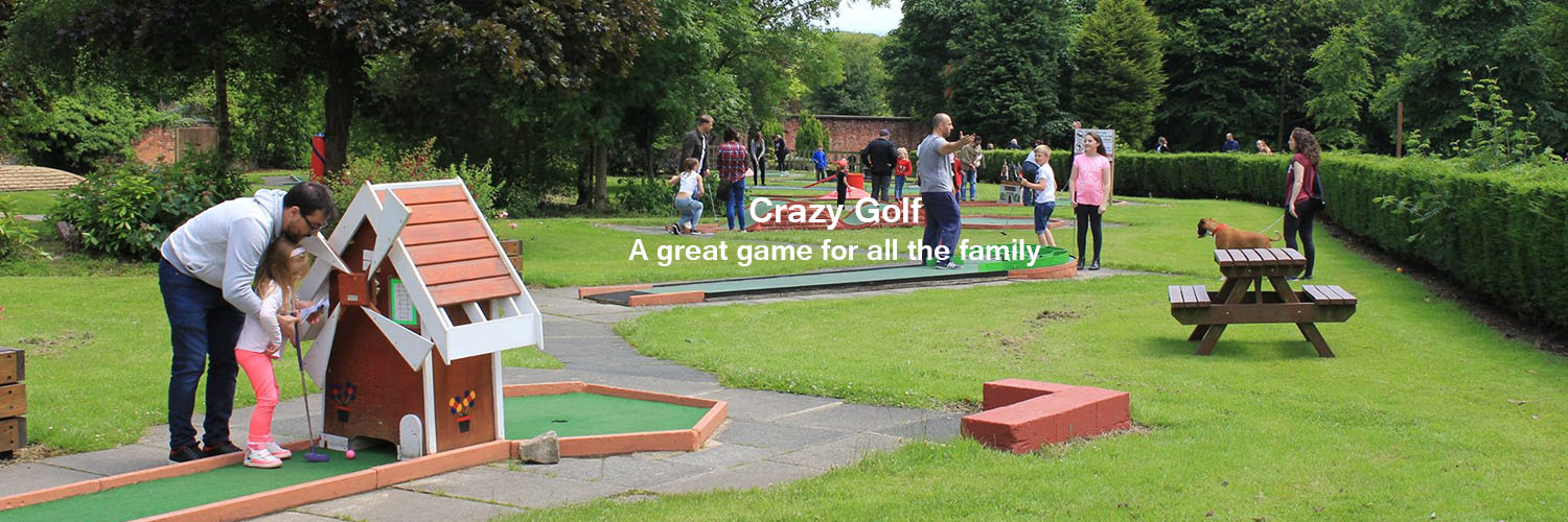 Families enjoying a game of Crazy Golf